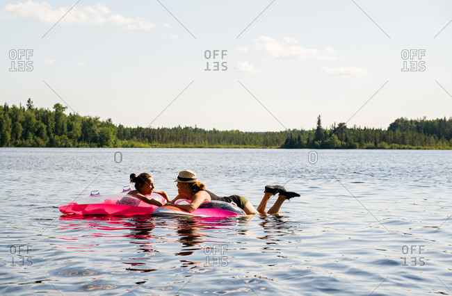 Two woman floating and talking together
