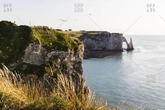 Elevated view along steep coast in front of Porte d'Aval, Cote d'Albatre, Pays de Caux, Seine-Maritime, Haute-Normandie, France