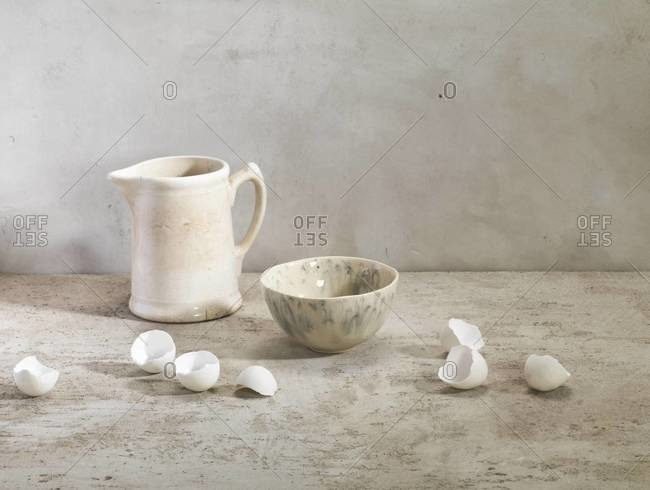 Egg shells with pitcher and bowl, studio shot