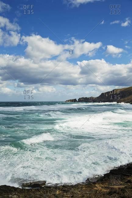 Clouds against Blue Sky over Breaking Waves, Majorca, Balearic Islands, Spain