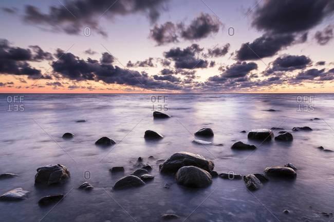 Rocks in Calm Water at Sunrise, Mons Klint, Baltic Sea, Mon Island, Zealand Region, Denmark