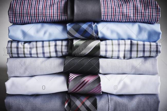 Close-up of stack of dress shirts with ties, studio shot