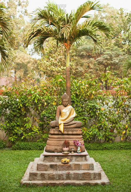 Siem Reap, Cambodia - February 24, 2009: Buddha statue in the resort garden of La Residence d'Angkor, Siem Reap, Cambodia