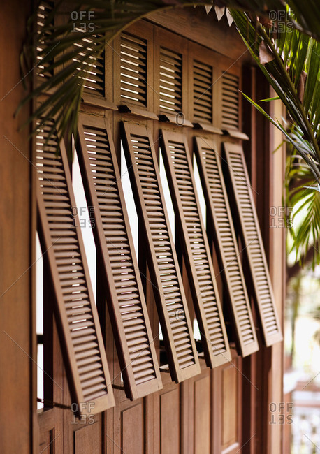 Siem Reap, Cambodia - February 24, 2009: An exterior shot of French-style shutters at La Residence d'Angkor, Siem Reap, Cambodia