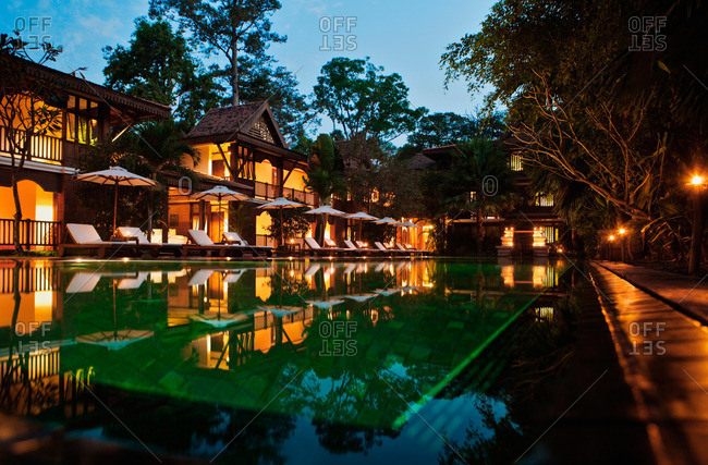 Siem Reap, Cambodia - February 24, 2009: The saltwater swimming pool at dusk, La Residence d'Angkor, Siem Reap, Cambodia