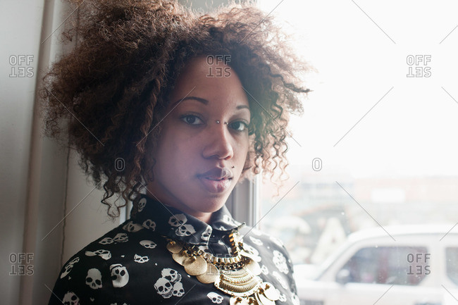 Cool young woman with piercings