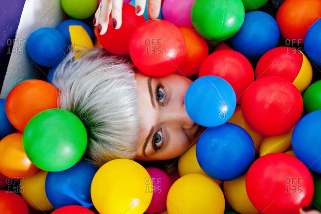 Young woman in a ball pit