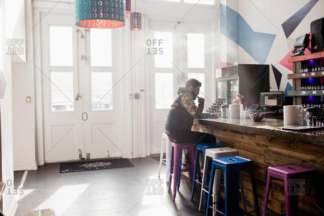 Young man at a cafe smoking