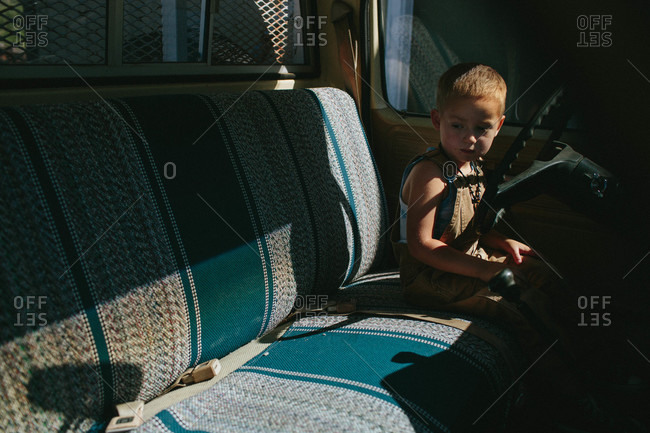 Little boy sitting on the seat of a truck
