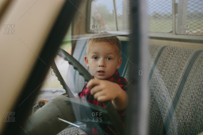Boy sitting in the cab of a truck