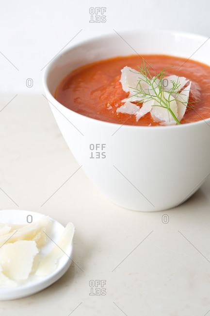 Tomato soup with a fennel sprig and shaved parmesan