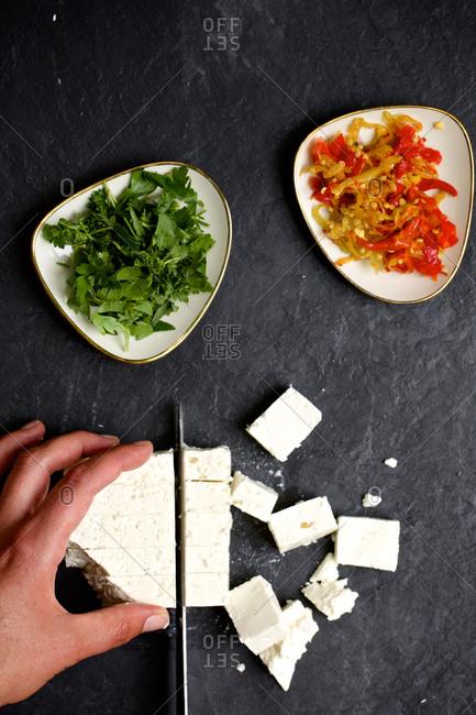 A cook chops feta