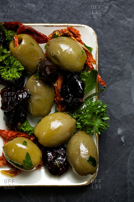 Sun-dried black olives and marinated green olives