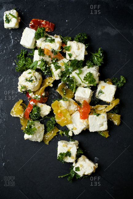 Feta cubes with herbs and pepper slices