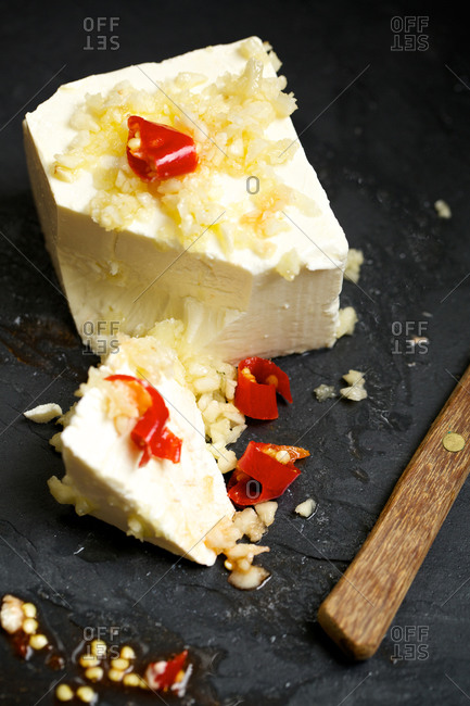Feta cheese with chopped garlic and pepper slices