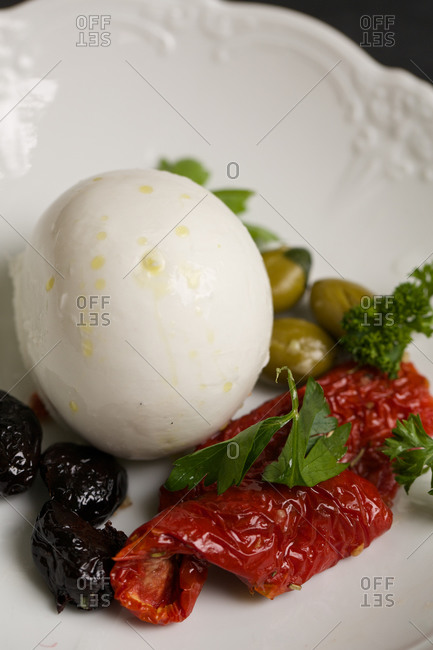 A mozzarella ball sun-dried olives and tomatoes