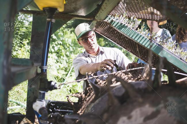 A man fixes his tractor