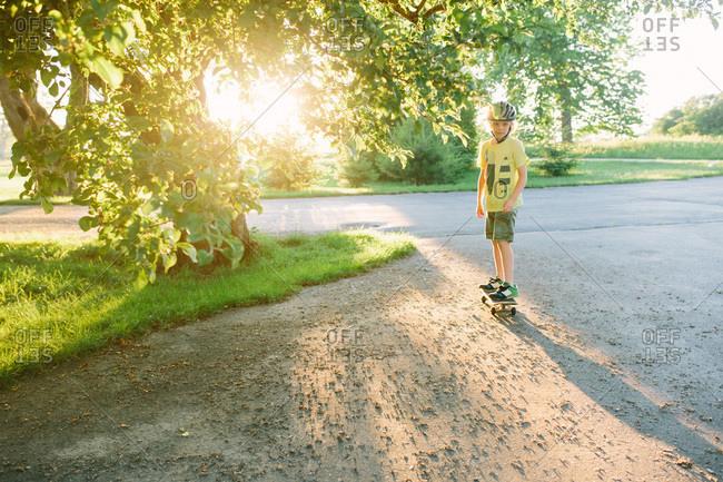 Boy on a skateboard in a driveway