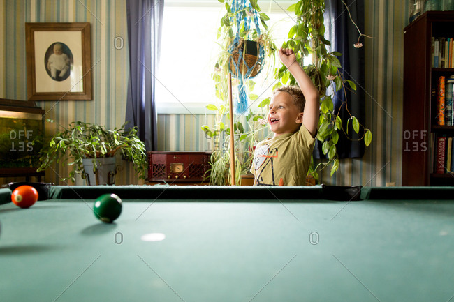 Boy celebrating a shot during pool game