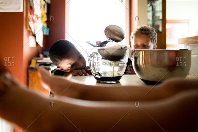 Kids filtering water through coffee into bowl
