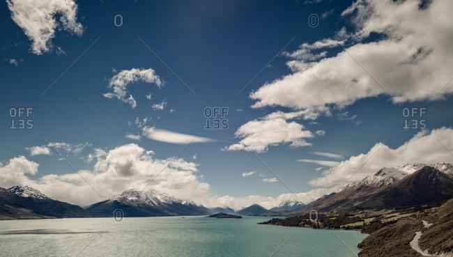Lake Wakatipu surrounded by mountains in New Zealand