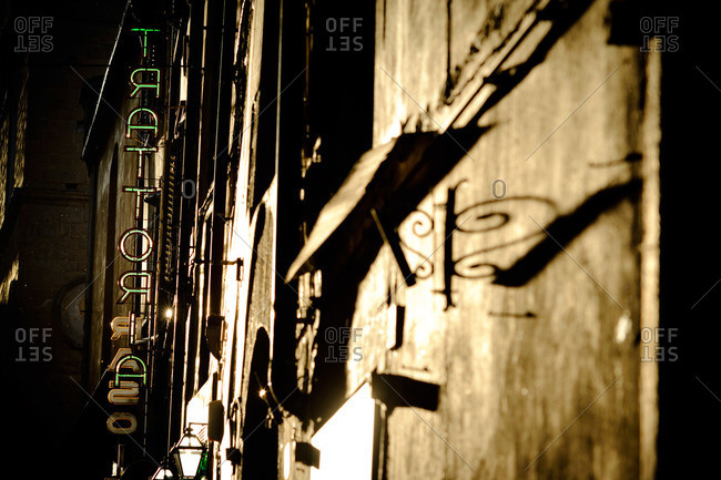 Trattoria sign on building in Florence, Italy