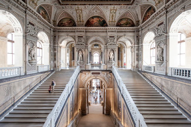 Vienna, Austria - June 8, 2012: Woman and child walking down stairs at Natural History Museum in Vienna