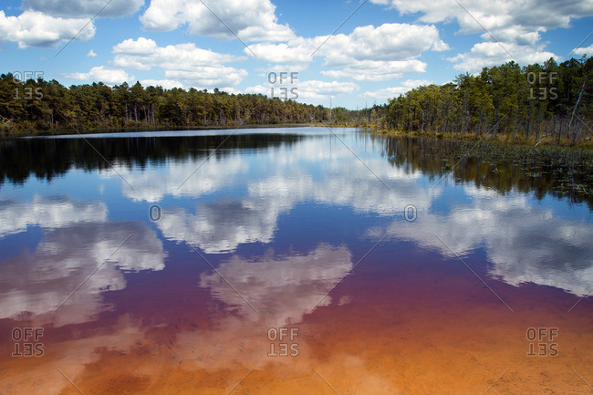 Sky reflected in colorful lake water