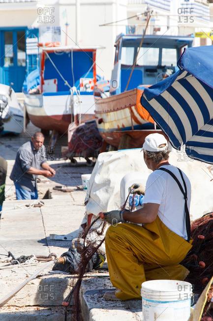 Mediterranean fishermen at shipyard