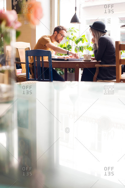 Man and woman playing backgammon in coffee shop