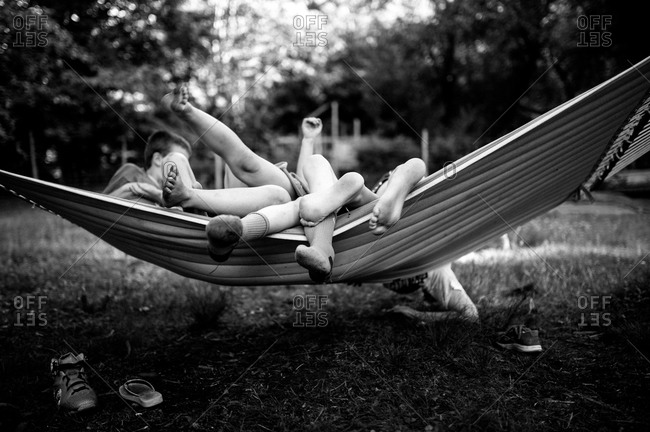 Children goofing around on a hammock