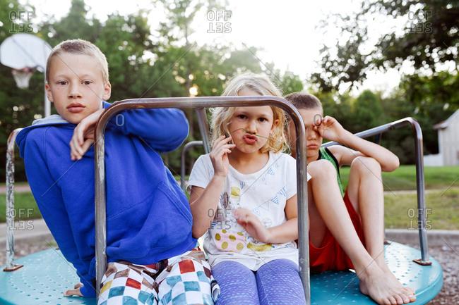 Children on a merry-go-round in a park