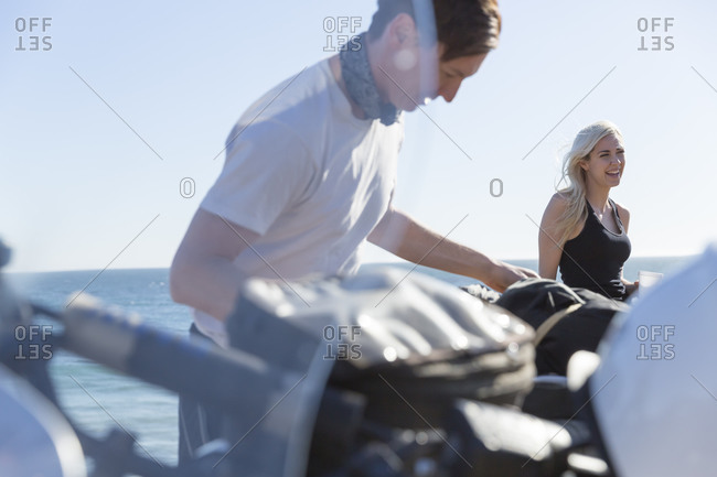 Young couple on a motorcycle trip