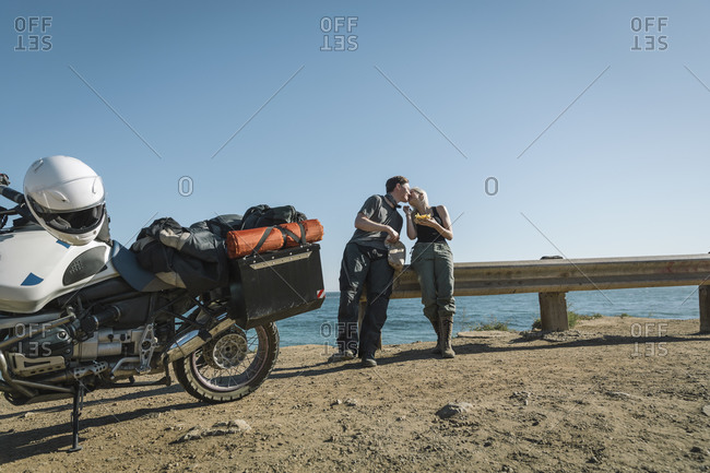 Couple taking a break from a motorcycle trip