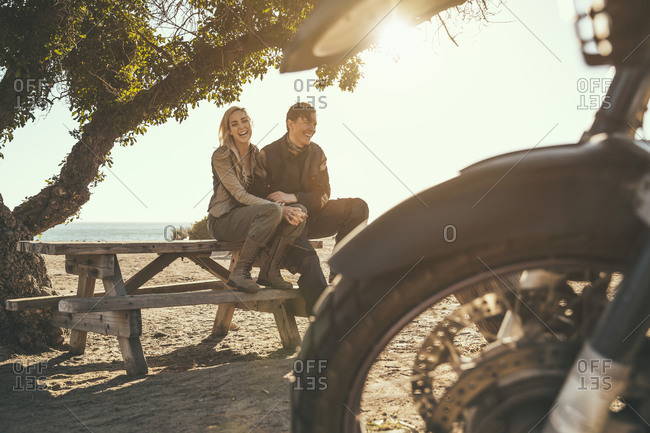 Couple on a motorcycle trip at the coast