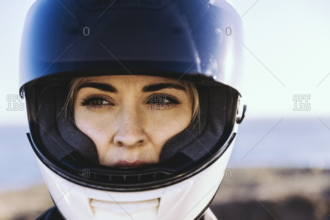 Woman wearing a motorcycle helmet