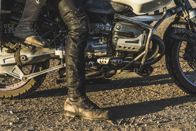 Detail of motorcyclist's clothing and footwear