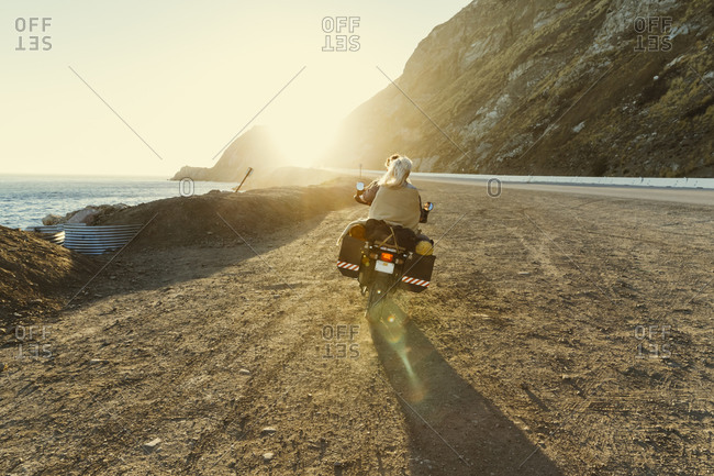 Motorcyclists riding off into the sunset
