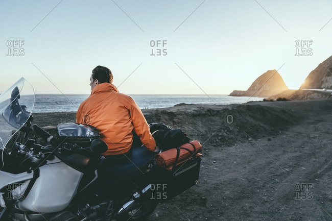 Motorcyclist looking out at the ocean