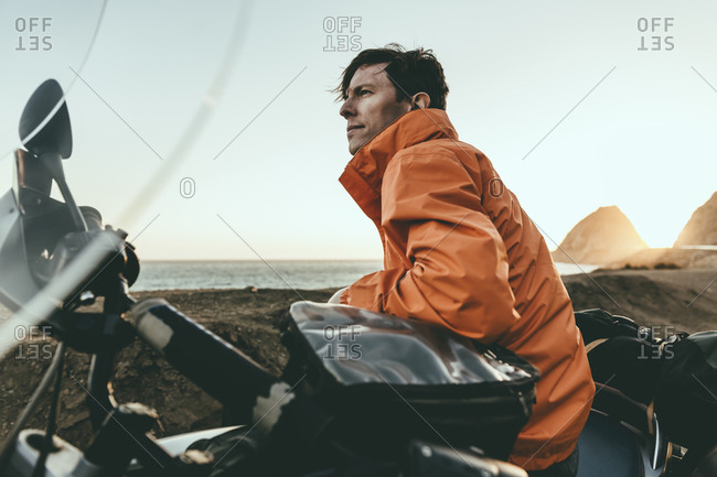 Motorcyclist looking out at the ocean view