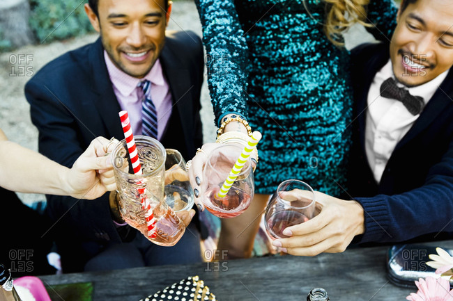 Friends clinking cocktail glasses