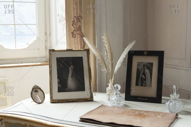 Photographs and quills on an antique desk