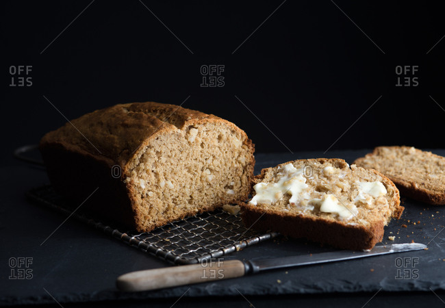 Banana bread sliced with butter