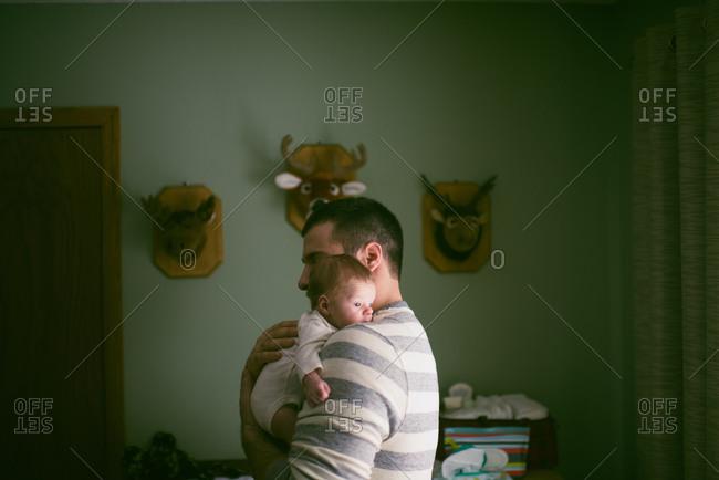 Father comforting newborn baby
