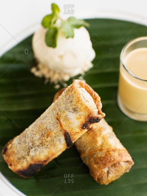 Chocolate and banana spring rolls with caramel sauce