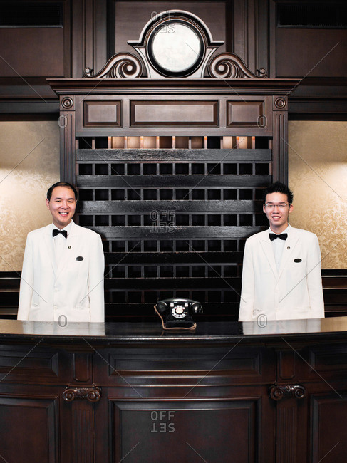 Penang, Malaysia - March 13, 2009: Receptionists at hotel in George Town, Penang, Malaysia
