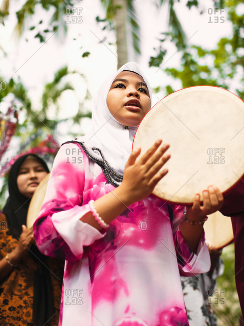Dungun, Malaysia - March 18, 2009: Women with drums in traditional Malaysian group