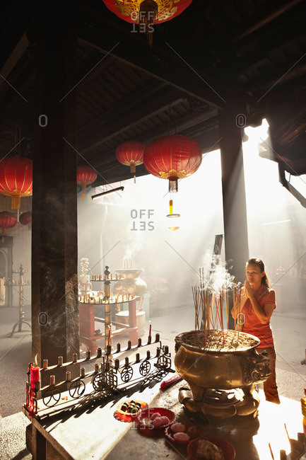 Penang, Malaysia - March 12, 2009: Woman prays at Temple of the Goddess of Mercy, Malaysia