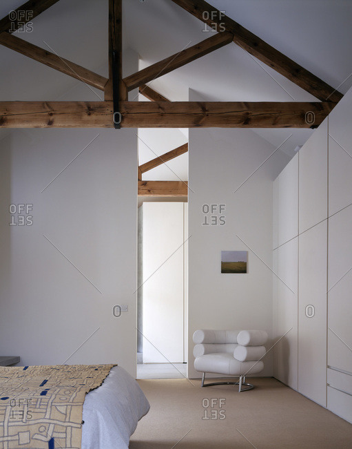 London, England-November 25, 2011: Modern bedroom with traditional wooden beams