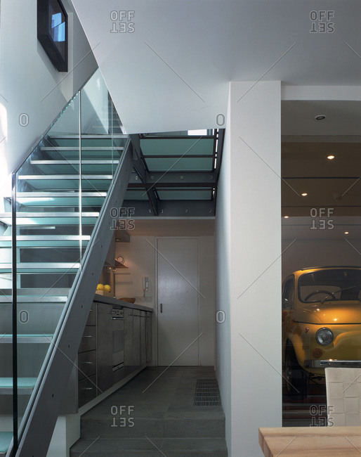 United Kingdom - January 1, 2009: Entrance of a modern home with a view of a car lift